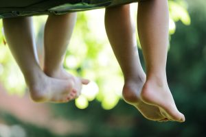 bigstock-Happy-children-sitting-on-gree-44758417